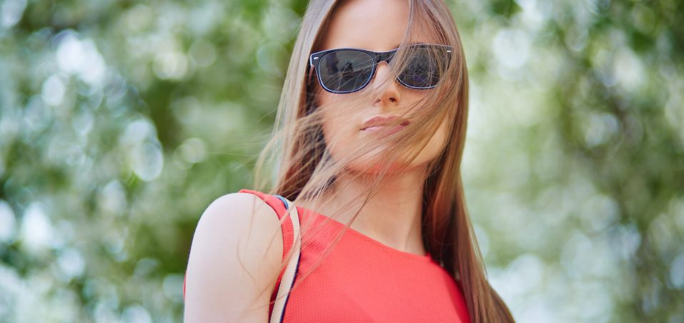 Portrait of stylish girl in sunglasses outdoors